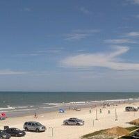 Photo taken at Coral Beach by Ryan J. on 8/11/2012