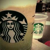 Photo taken at Starbucks by Katherina O. on 3/12/2011