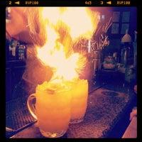 Photo taken at Bad Juju Tiki Bar by Kate M. on 5/5/2012