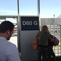 Photo taken at Gate D60 by Steve M. on 7/2/2012