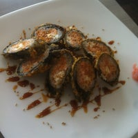 Photo taken at Planet Sushi by Jenell M. on 5/12/2012