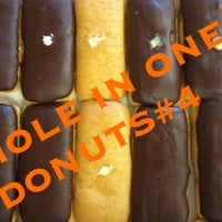 Photo taken at Hole In One Donuts by Cathie M. on 5/19/2012