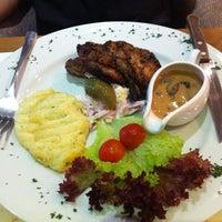 Photo taken at Cafe Eatology by Mellisa P. on 5/17/2012