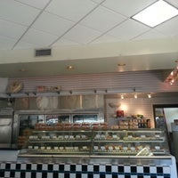 Photo taken at Phoenix Bakery by Leah P. on 7/24/2012