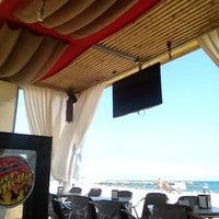 Photo taken at Chiringuito de la Mar Bella by GuiM on 8/28/2012