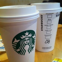 Photo taken at Starbucks by Catalina O. on 7/31/2012