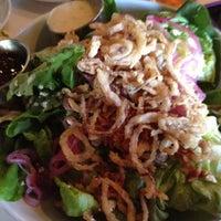 Photo taken at Romano's Macaroni Grill by Jennifer M. on 7/16/2012