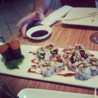 Photo taken at Pinto Thai Bistro & Sushi Bar by Michelle Y. on 8/4/2012