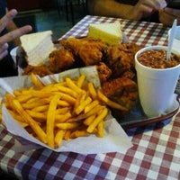 Photo taken at Gus's World Famous Hot & Spicy Fried Chicken by Jessica R. on 8/18/2012