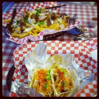 Photo taken at Pork Belly Grub Shack by Ian T. on 9/12/2012