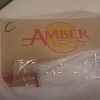 Photo taken at Amber Restaurant by Angelo B. on 4/13/2012