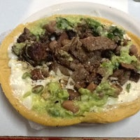 Photo taken at Tacos el Frances by Roxana P. on 6/2/2012