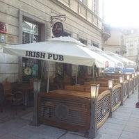 Photo taken at Irish Pub (Pub Irlandzki) by Dmitry S. on 6/13/2012