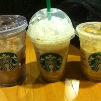 Photo taken at Starbucks by Trinh D. on 12/31/2011
