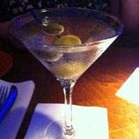 Photo taken at Mews Restaurant & Cafe by Jessie R. on 8/21/2011