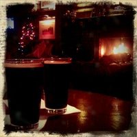 Photo taken at Bull & Bush Pub & Brewery by Rick R. on 12/2/2011