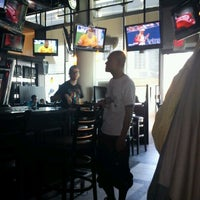 Photo taken at Hoops Sports Bar & Grill- Bremner by Matt S. on 8/27/2011