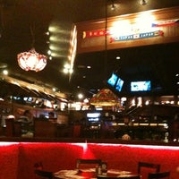 Photo taken at Fridays Montejo by Jose Rene C. on 8/14/2012