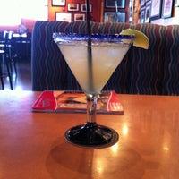 Photo taken at Boston's Restaurant & Sports Bar by Tawnee W. on 7/5/2012
