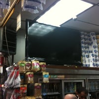 Photo taken at One brother Mini market by Christopher B. on 3/28/2012
