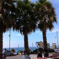 Photo taken at Spiaggia Santo Stefano Al Mare by Sabina on 8/16/2012