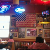 Photo taken at Red Robin Gourmet Burgers by Ruben T. on 6/25/2012