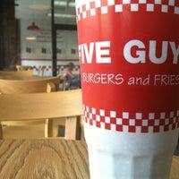 Photo taken at Five Guys by Bradley C. on 7/4/2012
