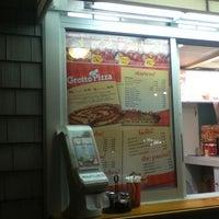 Photo taken at Grotto Pizza by Jonah A. on 7/28/2011