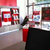 Photo taken at Vodafone Store by Erika M. on 12/22/2011