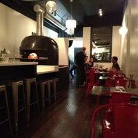 Photo taken at Mozzeria by Rebecca M. on 5/18/2012