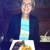 Photo taken at New Socials Bar & Grille by Helene on 7/3/2012
