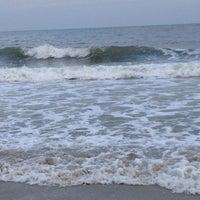 Photo taken at Pawleys Island Beach by Kathleen L. on 7/22/2012