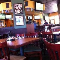 Photo taken at Oggi's Pizza & Brewing Company by Zayne R. on 8/14/2011