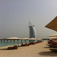 Photo taken at Madinat Jumeirah Private Beach by Giovanni D. on 5/18/2012