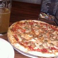 Photo taken at Red Devil Italian Restaurant & Pizzeria by Olivia W. on 10/18/2011
