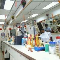 Photo taken at Kedai Gunting Rambut Bunga Raya by anuarnordin on 2/3/2012