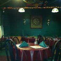 Photo taken at Little Bangkok Cuisine by Debbie V. on 12/17/2011