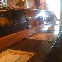Photo taken at Domo Japanese Restaurant & Sushi Bar by Melvina Q. on 4/6/2011