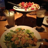 Photo taken at BJ's Restaurant and Brewhouse by Yvette G. on 7/5/2012