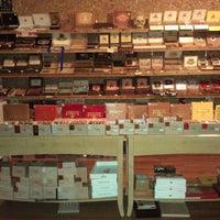Photo taken at Outman Cigars & Martini Bar by Jason K. on 10/28/2011