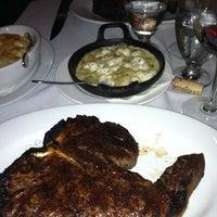 Photo taken at Dino & Harrys Steakhouse by Michael W. on 9/22/2011