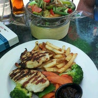 Photo taken at Harbour Sports Grille by Marie R. on 8/24/2012