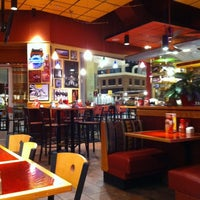 Photo taken at Red Robin Gourmet Burgers by Tiffany P. on 12/1/2011