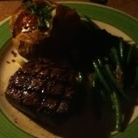 Photo taken at Wolf Creek Steakhouse by Patricia B. on 3/4/2012