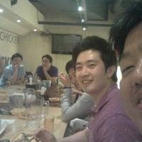 Photo taken at 깐부치킨 (kkanbu chicken) by Namyoul K. on 6/13/2012