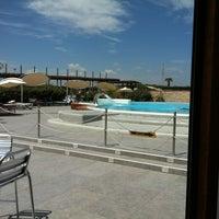 Photo taken at Corallo beach by Adriana on 7/22/2012