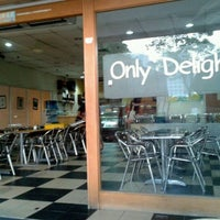 Photo taken at Only Delights Cafe by Steve L. on 2/8/2012