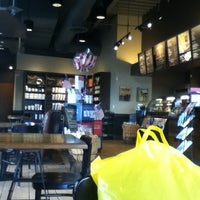 Photo taken at Starbucks by Madao C. on 6/22/2012