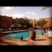 Photo taken at Kasbah Tizimi Hotel Erfoud by Jordan H. on 5/28/2012