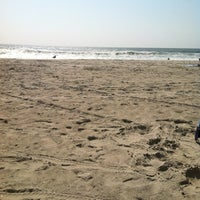 Photo taken at 12th Street Beach by Eric B. on 9/7/2012